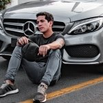 Influencers in front of a mercedes car