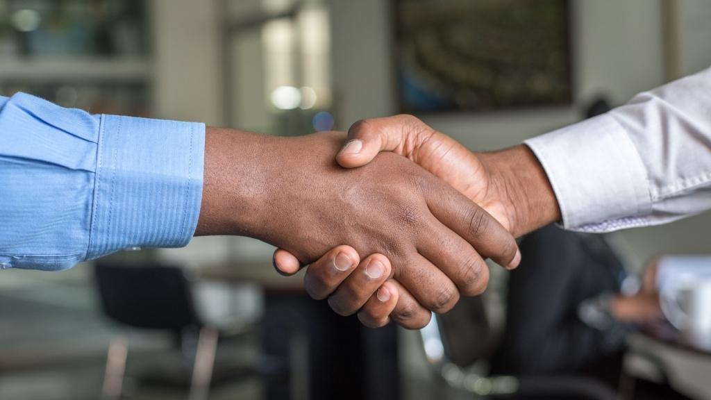 event-analytics-booth-visitor-business-handshake