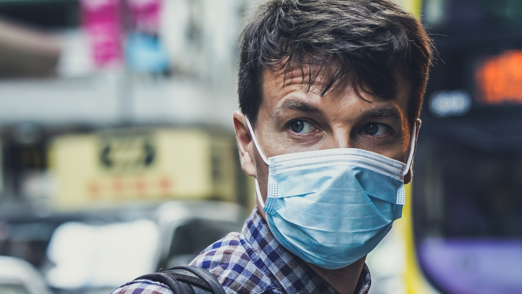 use face mask to protect from coronavirus, bacteria and airborne germs on trade shows and exhibition
